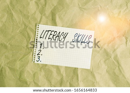 Text sign showing Literacy Skills. Conceptual photo all knowledge and skills need to evaluate information Papercraft craft paper desk square spiral notebook office study supplies. #1656164833