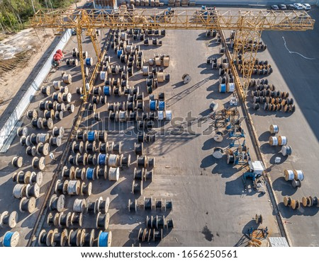 large strelarge street warehouse of electric cable from a bird's eye viewet warehouse of electric cable #1656250561