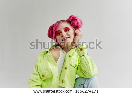 young woman looking at the camera isolated background