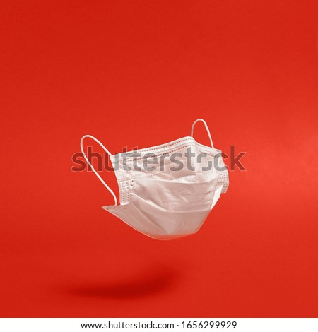 Surgical face mask on red background. Minimal medical concept. Medical equipment #1656299929