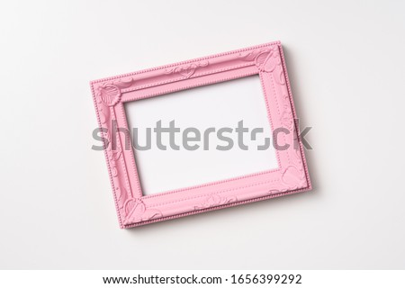 Design concept - top view of pink vintage wood photo frame isolated on white background for mockup, it's real photo, not 3D render