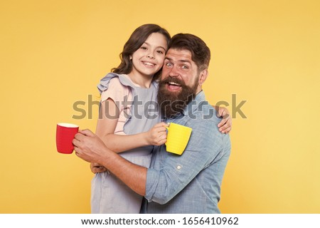 Drink water. Drink fresh juice. Breakfast concept. Good morning. Having coffee together. Lovely family tradition. Drinking tea. Bearded man and happy girl holding mugs. Father and daughter hot drink. #1656410962
