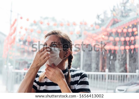 Woman who puts a mask on his face. Virus concept #1656413002