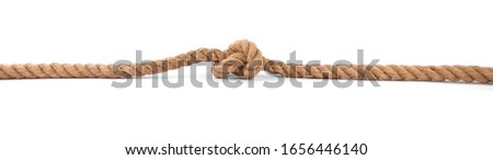 Strong Rope with a Knot on white Background Royalty-Free Stock Photo #1656446140