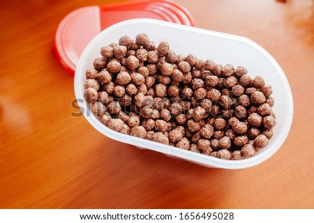 a full jar of chocolate flakes with Breakfast balls. Children's Breakfast option. Ingredients for cooking. #1656495028