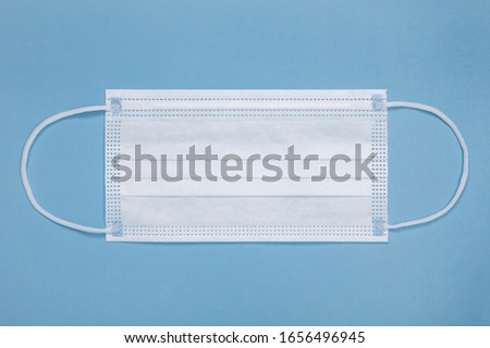 White medical mask isolated on blue background. Medical mask protection against pollution, virus, flu, coughing and coronavirus. Health care and surgical concept. #1656496945