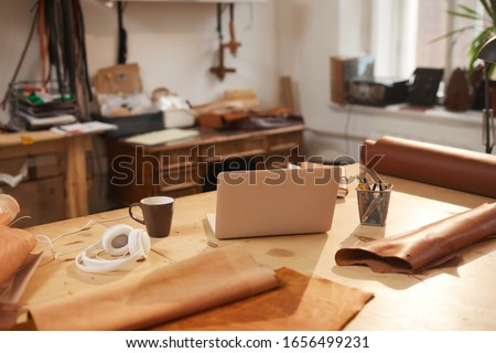 Horizontal no people shot of modern leather craft workshop room interior, daytime Royalty-Free Stock Photo #1656499231