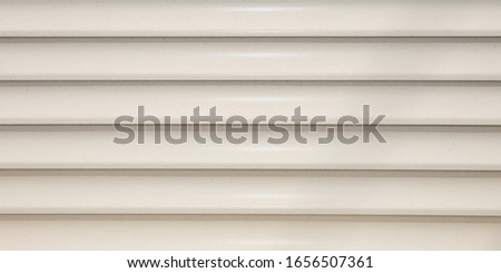 Background pattern of steel shuttle rolling shutter metal gate metal curtain backdrop of modern door home