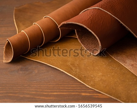 Genuine Leather. Sewing a purse. Leather work. Tools for sewing bags, wallets, clutches. Stitching. Manual sewing of the product. The manufacture of leather products.  #1656539545