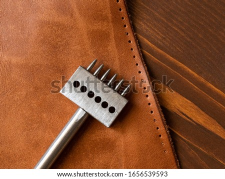 Genuine Leather. Sewing a purse. Leather work. Tools for sewing bags, wallets, clutches. Stitching. Manual sewing of the product. The manufacture of leather products.  #1656539593