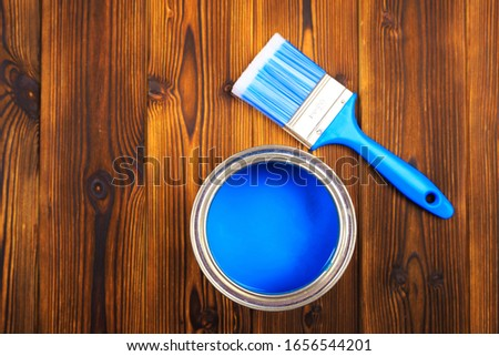 House renovation, paint can on the old wooden background with copy space #1656544201