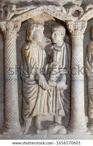 Jaen, Spain - December 29th, 2017: Resurrection of the dead of The Young Man from Nain Jesus miracle. Paleochristian sarcophagus of Martos, 330 AC. Jaen Museum, Spain #1656570601