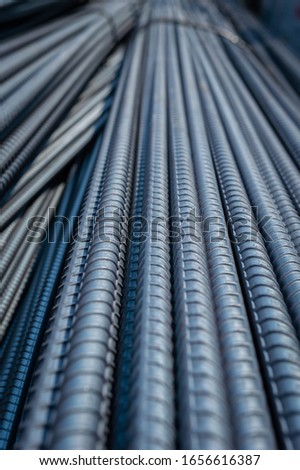Construction steel rods or bars work reinforcement in conncrete structure of building.Background texture of steel rods or bars used in construction to reinforce concrete #1656616387