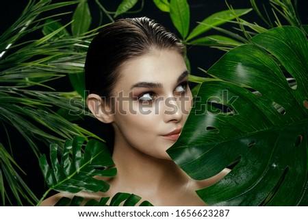 Beautiful woman green leaves charm naked shoulders island spa treatments #1656623287