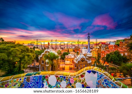 Beautiful sunrise in Barcelona seen from Park Guell. Park was built from 1900 to 1914 and was officially opened as a public park in 1926. In 1984, UNESCO declared the park a World Heritage Site #1656628189