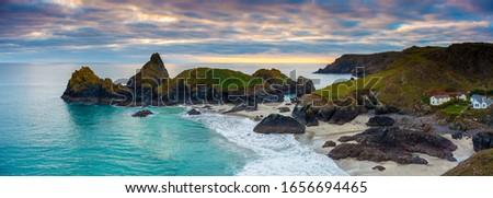 Panoramic shot at sunset overlooking the beach at Kynance Cove Cornwall England UK