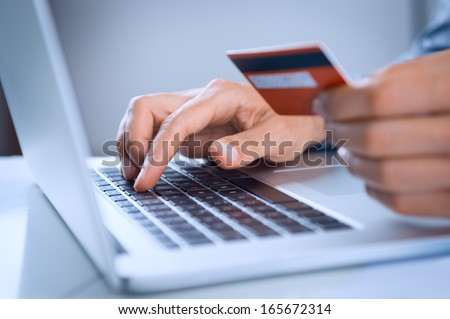 Close Up Of A Man Shopping Online Using Laptop With Credit Card Royalty-Free Stock Photo #165672314