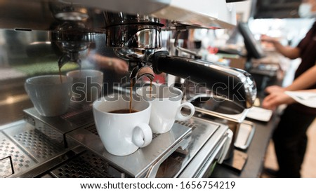 two black coffee morning on coffee maker