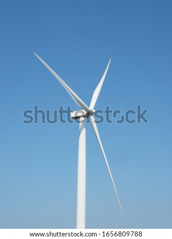 Wind turbines generating electricity with blue sky - energy conservation concept  #1656809788