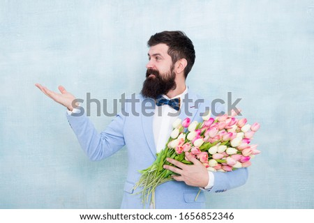 Flowers shop. Ideas to celebrate without breaking bank. Spring mood. Love date. Gift bouquet. Bearded man hipster with flower bouquet. Flower bouquet for womens day. Bearded man with tulips. #1656852346