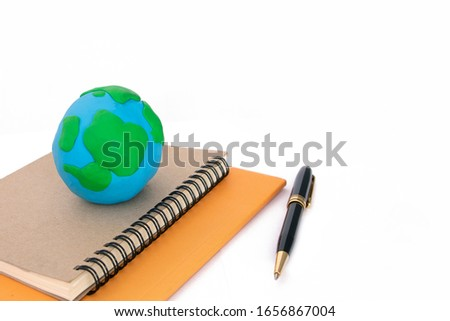 Planting tree in green globe on the book, Environment conservation ,Environment learning concept #1656867004