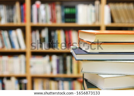 Stack of Books on the table in library #1656873133