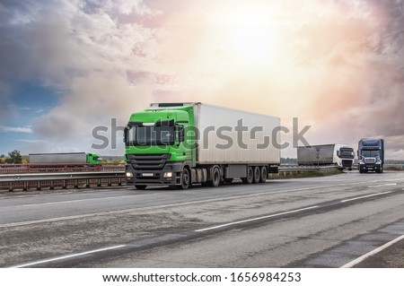 Trucks Moves on the Country Highway #1656984253
