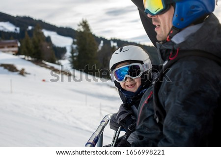 Family, skiing in winter ski resort on a sunny day, enjoying scenery landscape #1656998221