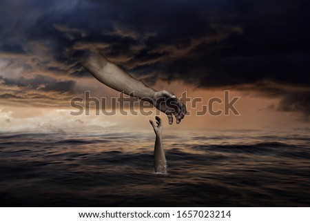 God Hand from Sky is Reaching Towards Man Hand that is Sinking Down in Ocean-Christian concept Royalty-Free Stock Photo #1657023214