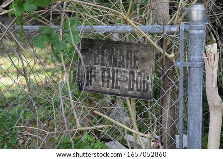 old weathered beware of dog sign abandonded #1657052860