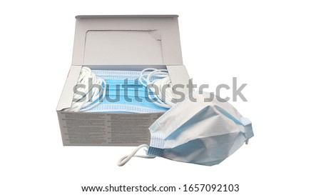 Disposable face masks in a package or box, isolated. Surgical masks, also known as a procedure masks. #1657092103