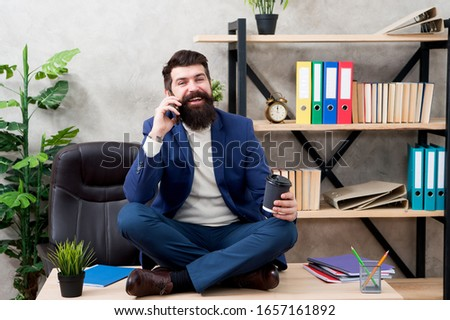 mature man speak on phone while drinking coffee. business negotiations at coffee break. sharing good news. mobile phone conversation. receive calls during business lunch. free time to relax. #1657161892