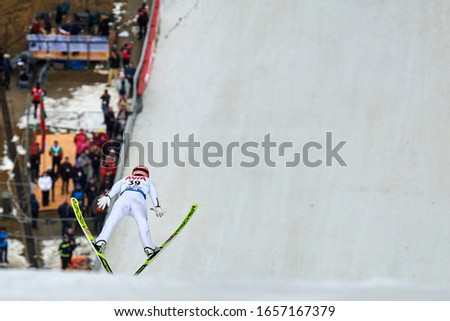 Rasnov, Romania - 20 th-22th February 2020: Unknown ski jumper compets to win the Man World Cup Ski Jumping event in Rasnov, Romania in motion blur, Blurred background #1657167379