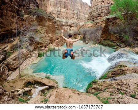 time lapse photography of man jumping on waterfalls #1657175767