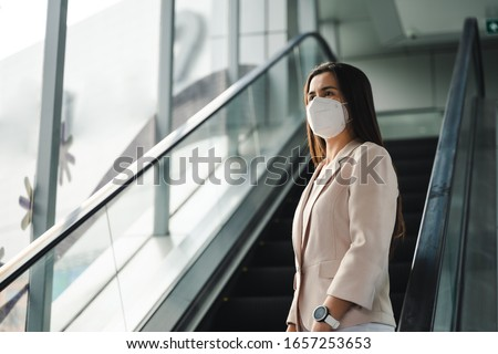 Asian woman wearing N95 mask to protect pollution PM2.5 and virus. COVID-19 Coronavirus and Air pollution pm2.5 concept. #1657253653