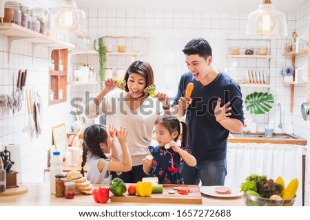 Asian family enjoy playing and cooking food in kitchen at home #1657272688