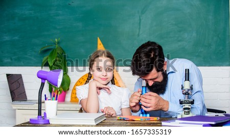 Girl pupil study with bearded teacher. Studying methods for children. School education. Extra classes. Cognitive skills concept. Schoolgirl likes study with father. Study hard. Following example. #1657335319