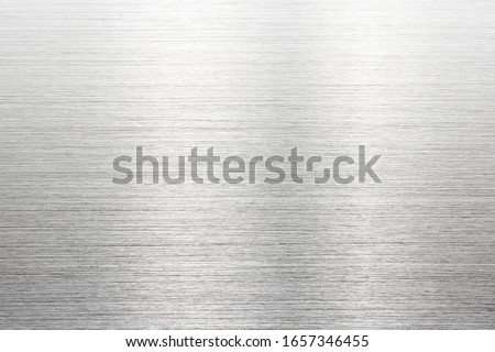 Fine brushed metal with reflection. Photograph of brushed metal, or hair line pattern metal. High resolution Sharp to the corners. #1657346455