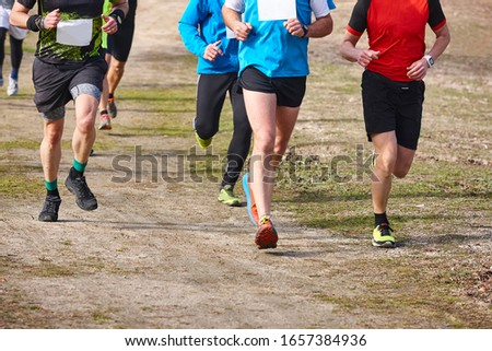 Cross country runners on a race. Active healthy outdoor lifestyle #1657384936