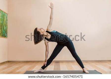 young attractive brunette girl practicing yoga from the Studio #1657405471