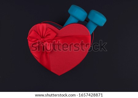 Gift for February 14 and March 8 in a beautiful box, dumbbells. The concept of losing weight with love. Sports equipment #1657428871