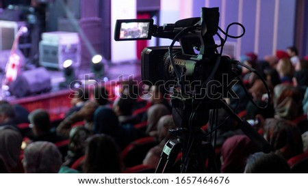 Recording and broadcasting live concerts on camcorders. Professional Video Recording Business Royalty-Free Stock Photo #1657464676
