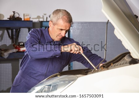 Mechatronics engineer at the repair of the car engine or engine tuning in the workshop #1657503091