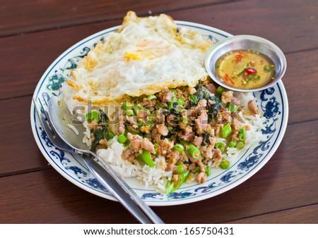 Stir fried pork with basil and egg on rice #165750431