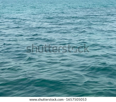 Blue surface.  Water surface that is not smooth from the waves #1657505053