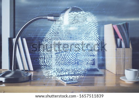 Computer on desktop in office with finger print drawing. Double exposure. Concept of business data security. #1657511839