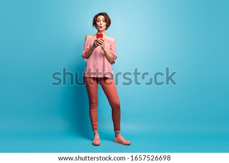 Full length body size view of her she nice attractive amazed brown-haired girl using cell web service 5g pout lips isolated over bright vivid shine vibrant blue color background