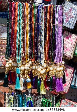 Set of praying beads of various colors in view #1657558498