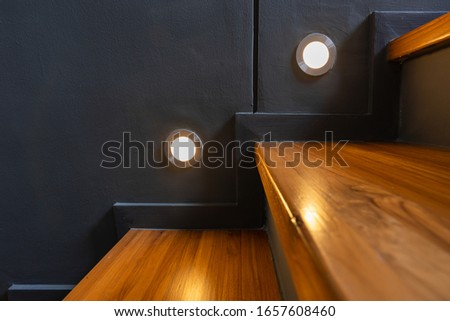 Stairway lights bulb for illumination as safety protection wooden stairs architecture interior design of contemporary, Modern house building stairway Royalty-Free Stock Photo #1657608460