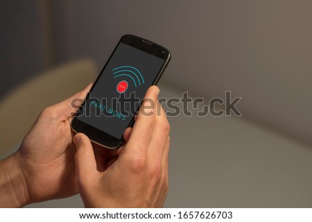 Hands holding smartphone with fake news and send button on the screen. #1657626703